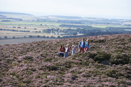 16 year old girls: Group Of Young People Hiking Through Countryside Stock Photo