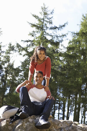 Young Couple Hiking Through Countryside photo