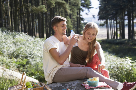 17 year old: Young Couple Enjoying Picnic In Countryside