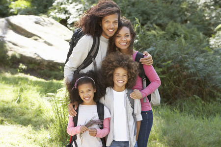 outdoor pursuit: Family Group Hiking In Woods Together Stock Photo