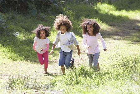 children playing together: Three Children Playing In Woods Together