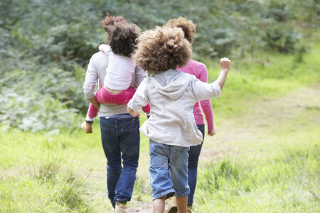 two year old: Family Group Walking In Countryside Stock Photo