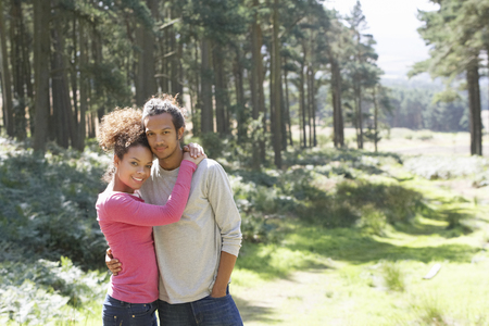 Romantic Young Couple Walking In Countryside photo