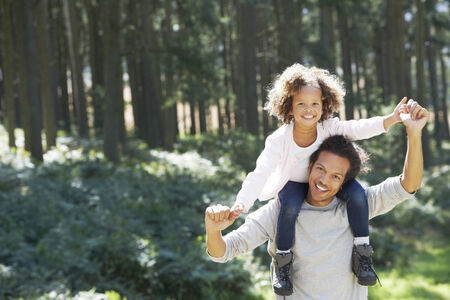 Father Giving Daughter Ride On Shoulders In Countryside photo