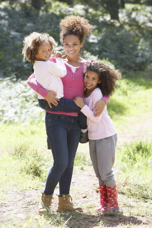 5 10 year old girl: Portrait Of Mother With Daughters In Countryside