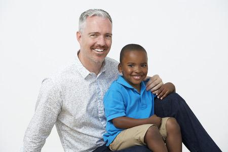 pre schooler: Studio Portrait Of Male Pre School Teacher With Pupils