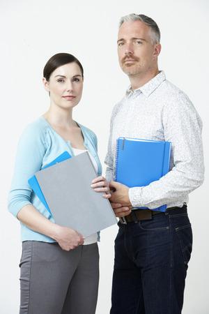 Studio Portrait Of Male And Female Pre School Teachers Stock Photo