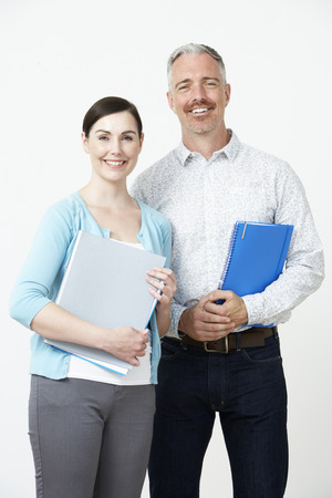 pre schooler: Studio Portrait Of Male And Female Pre School Teachers Stock Photo