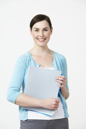 pre schooler: Studio Portrait Of Female Pre School Teacher Stock Photo