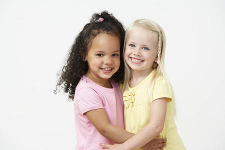 schooler: Two Pre School Girls Hugging One Another