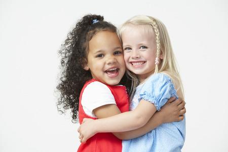 pre schooler: Two Pre School Girls Hugging One Another