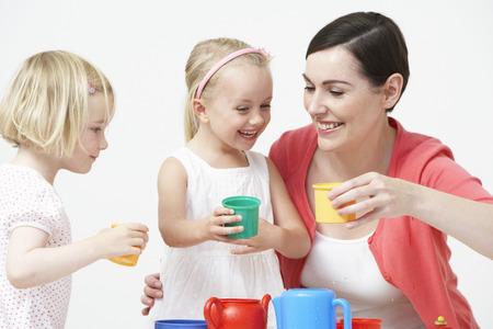 Pre School Children Enjoying Tea Party With Teacher photo