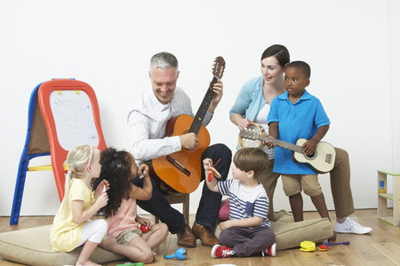 playing music: Pre School Music Lesson Stock Photo