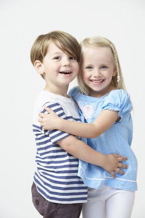 pre schooler: Two Pre School Pupils Hugging One Another