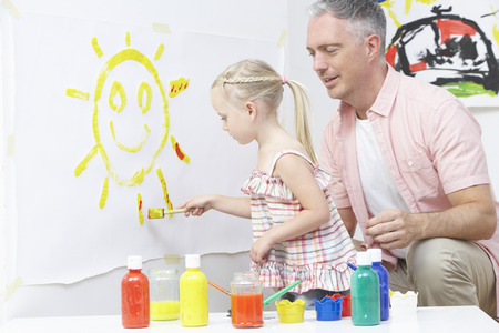 pre school: Teacher And Pupil In Pre School Art Class