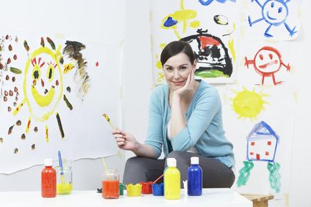 pre schooler: Teacher In Pre School Art Class Stock Photo