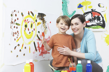 pre schooler: Teacher And Pupil In Pre School Art Class