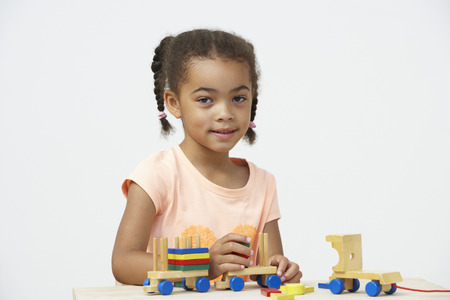 Pre-School Pupil Playing With Wooden Toy Train photo