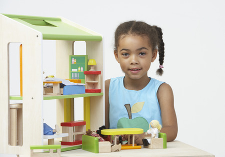 pre schooler: Pre-School Pupil Playing With Wooden House