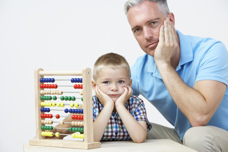 pre schooler: Puzzled Father And Son Looking Abacus