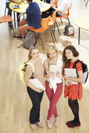 Overhead Shot Of Female Students Standing In Cafeteria photo