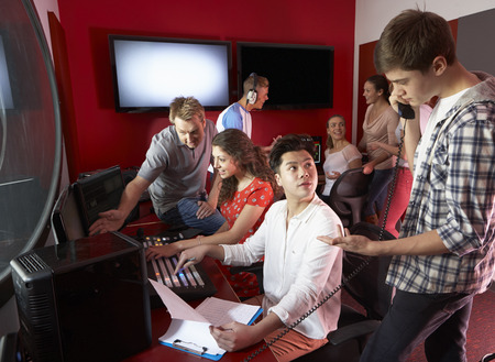 film editing: Group Of Media Students Working In Film Editing Class