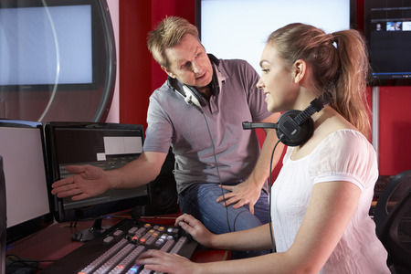 film editing: Media Student With Tutor Working In Film Editing Class Stock Photo