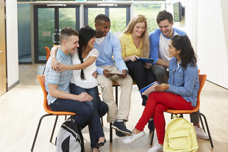 boy 16 year old: Multi-Ethnic Group Of Students In Classroom Stock Photo
