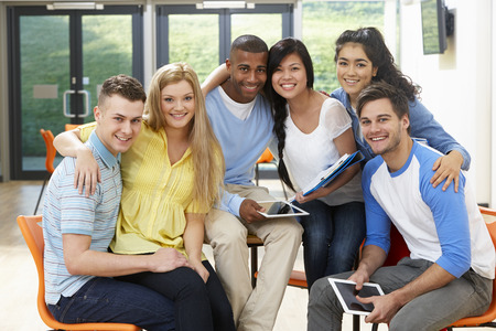 digital school: Multi-Ethnic Group Of Students In Classroom Stock Photo