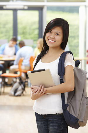 filipino adult: Portrait Of Female Student In Classroom With Digital Tablet Stock Photo