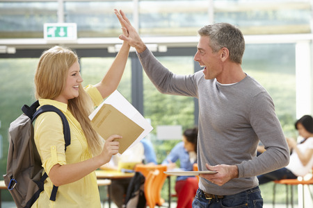 16 year old: Teacher Congratulating Pupil On Successful Exam Result