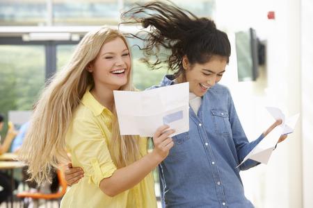 Two Teenage Pupils Celebrating Successful Exam Result