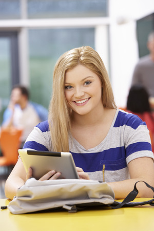 16 year old girls: Female Teenage Student In Classroom With Digital Tablet Stock Photo