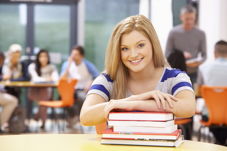 16 year old girls: Female Teenage Student In Classroom With Books