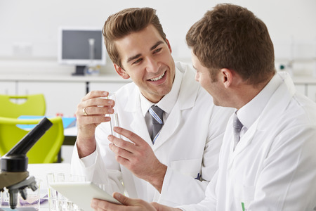 Two Technicians Working In Laboratory photo