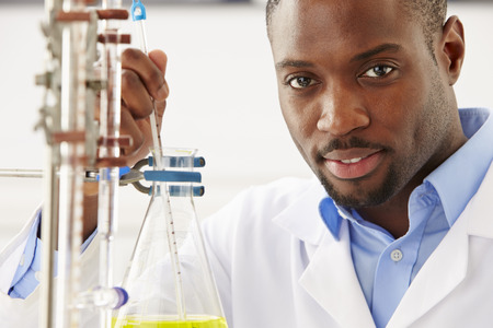 Scientist Studying Liquid In Flask Stock Photo