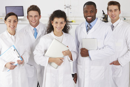 Portrait Of Laboratory Technicians Standing In Group photo