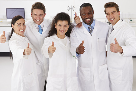 lab technician: Portrait Of Laboratory Technicians Standing In Group