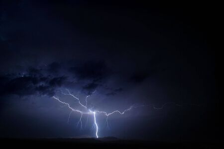 wheather: a lightning in a stormy wheather outside the city