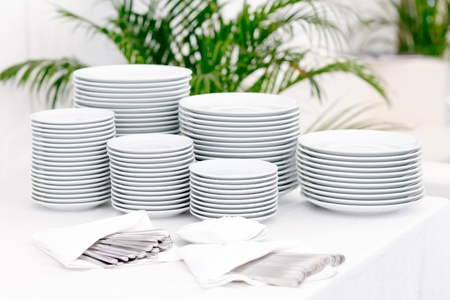 small plate: Stacks of plates for a buffet