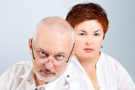 parental control: Serious parents expressing their concern and worry Stock Photo