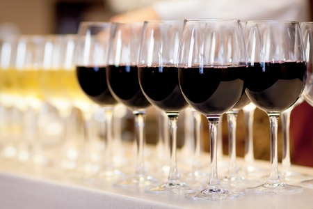 lined up: Glasses of red and white wine.