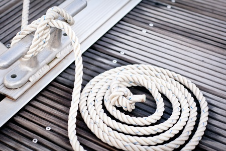 knotted: Mooring rope with a knotted end tied around a cleat   Stock Photo