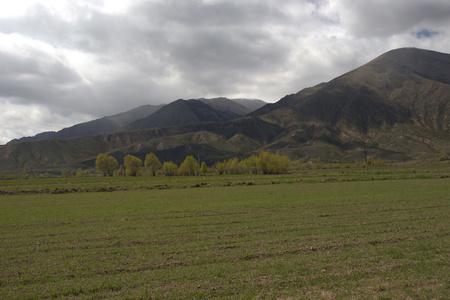 Kyrgyzstan's mountain view from Grigorievka village in spring