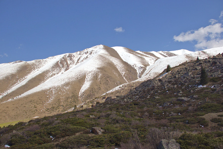 Mountain landscapes of Kyrgyzstan. Spring in the mountains. Near Kor Tor lake.