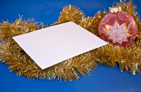Christmas card with a sphere and tinsel Stock Photo - 16373648