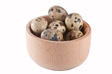 quail eggs in a wooden bowl Stock Photo - 16489660