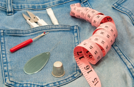 Sewing accessories on jeans Stock Photo - 16479397