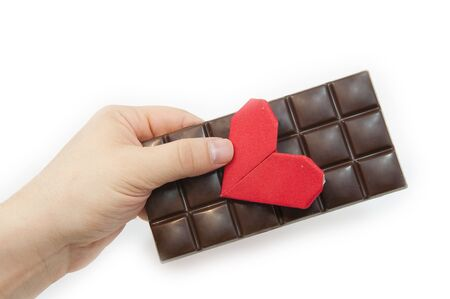 The man s hand holds a Valentine s Day card and chocolate Stock Photo - 17365979