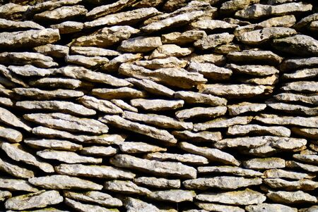 Wall of flat stones